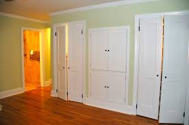 high white wooden sliding glass doors with double doors placed on