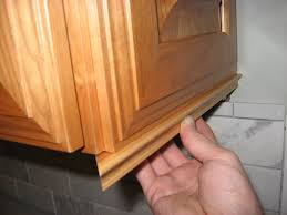 Add Trim To Kitchen Cabinets by Add Molding To Hide Under Cabinet Lights And Outlets Kitchen