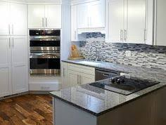 White Kitchen Cabinets With Granite Countertops by White Kitchen Cabinets Gray Granite Countertops New Caledonia