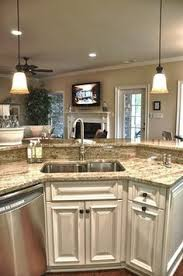 Kitchen Island With Sink Neutral Wall And Floor Colors Allow The Granite Countertops Of