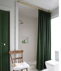love the linen shower curtain and rod hung from ceiling linen