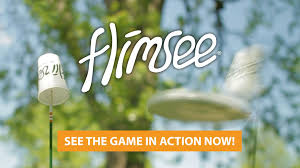 flimsee a lawn game played with cups poles and a frisbee
