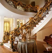 foxy image of christmas staircase decoration using gold baubles
