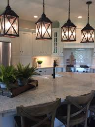 kitchen lighting island cream painted cabinetry with carrara counter tops classic white