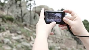 man streaming an action movie over his smartphone through wifi i