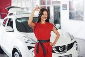 who is the girl in the new nissan altima commercial smiling car salesman handing over your new car keys dealership