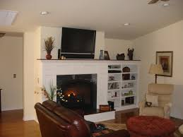 stone fireplace surround using white wooden shelf among white