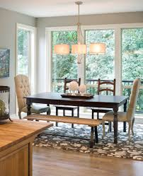 decorating transitional dining room with patterned rug plus bench