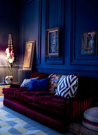 Blue Rooms royal blue walls and deep plum sofa give this room drama dark