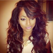 pic of black women side swept bangs and bun hairstyle long side swept straight weaves for black hairstyles with side
