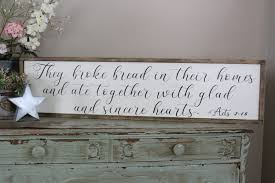 they broke bread in their homes and ate together wood sign
