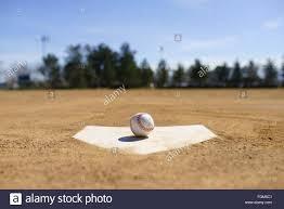 baseball on a home plate in a baseball field in california