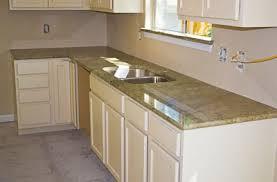 white kitchen cabinets with green granite countertops surf green granite for a kitchen peninsula