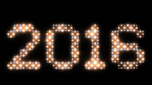 bright flood lights form the happy new year text gold tint