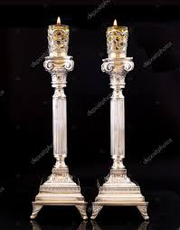 shabbat candles shabbat candles silver candlesticks with olive stock photo