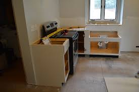 Fitting Kitchen Cabinets How To Install Kitchen Cabinets On Concrete Walls Kitchen