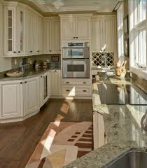 kitchen floor ideas with white cabinets home design treated white cabinets add the old fashioned look this compact kitchen featuring geometric rug