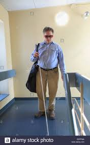 What Is Congenital Blindness Man With Congenital Blindness Using His Cane In An Apartment