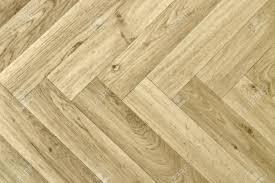 artificial wood flooring full frame detail of a artificial wooden parquet floor stock photo