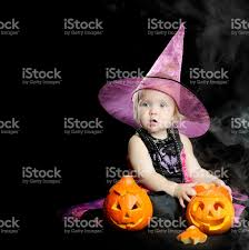 halloween black background pumpkin halloween little witch with pumpkin over black background