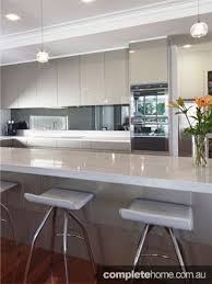 Kitchen Benchtop Designs White Gloss Cabinetry And Grey Benchtops For The Kitchen Opposite