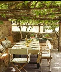 rustic patio ideas with pergola and climbing plants and furniture
