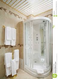 clean bathroom with shower cabin and hangers stock photo image