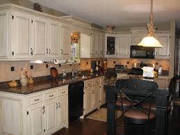 black brown kitchen cabinets white speckle countertops with black appliances pics of kitchens