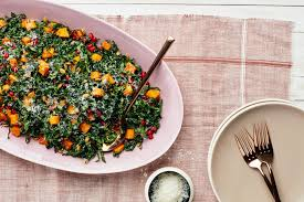 kale salad with butternut squash pomegranate and pumpkin seeds
