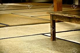 traditional japanese room covered with tatami mats and a flat