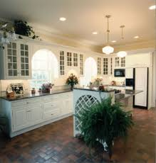 classic kitchen decorating ideas with terra cotta floor and wooden