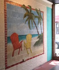 beach scene finished mural with brick window detail