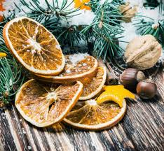 dried oranges with nuts and fir branches on the floor christmas
