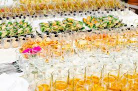 a lot of cold snacks and drinks on buffet table catering stock