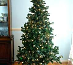 cheap christmas tree how to make a christmas tree look fuller tree look