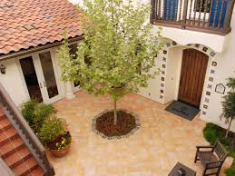 Spanish Style Courtyards by Southwestern Tile Courtyard Patio With Barrel Tile Roof The Square