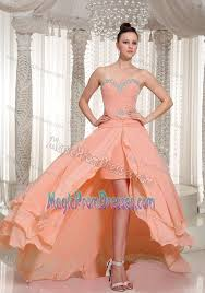 low prom dress in peach pink with beading and ruching in chewelah