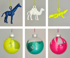 this buy clear ornaments and drip gold paint into them and