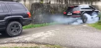 jeep audi audi sq7 vs jeep grand cherokee street tug of war gets violent