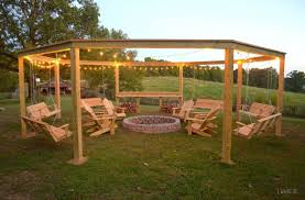 how to build a pergola with a fire pit by little white house blog