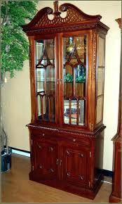 lighted curio cabinet oak corner lighted curio cabinet sei golden oak mahogany mirrored