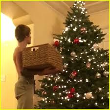 justin bieber goes shirtless while decorating his tree