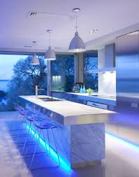 creative kitchen storage with kitchen island and blue lighting