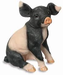 large floppy eared black and white sitting pig garden ornament