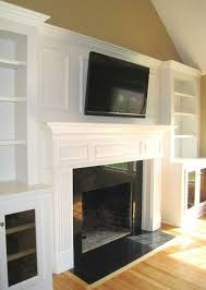 living room and fireplace with bookshelves maybe do board batten behind fireplace to blend