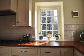 window white kitchen cabinets and white subway tile backsplash