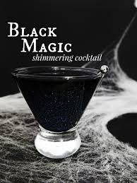 green cocktail black background black magic cocktail recipe halloween cocktails orange juice