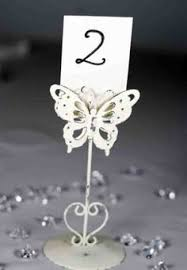 Vintage Table Number Holders Lead The Banquet Guests To Their Table With These Butterfly Table