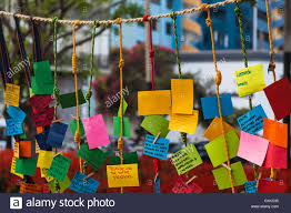 notes thoughts and wishes in hanging on ropes stock photo
