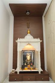 design of pooja room within a house decor storage spaces